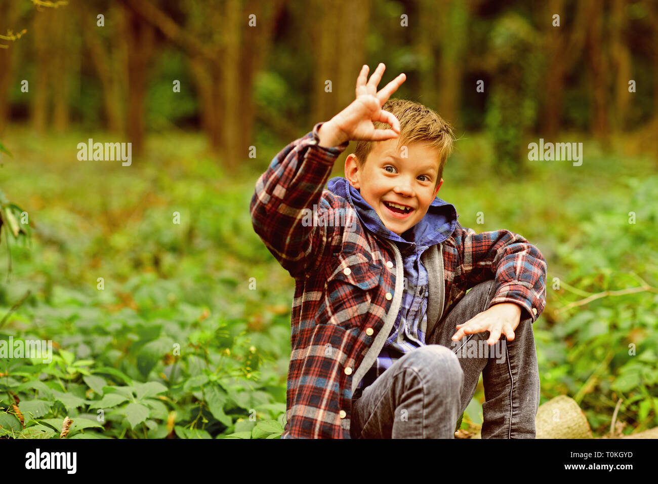 I feel ok. Little boy show ok sign. Happy little boy. Small boy enjoy day in woods. Just relax, everything is ok - Stock Image