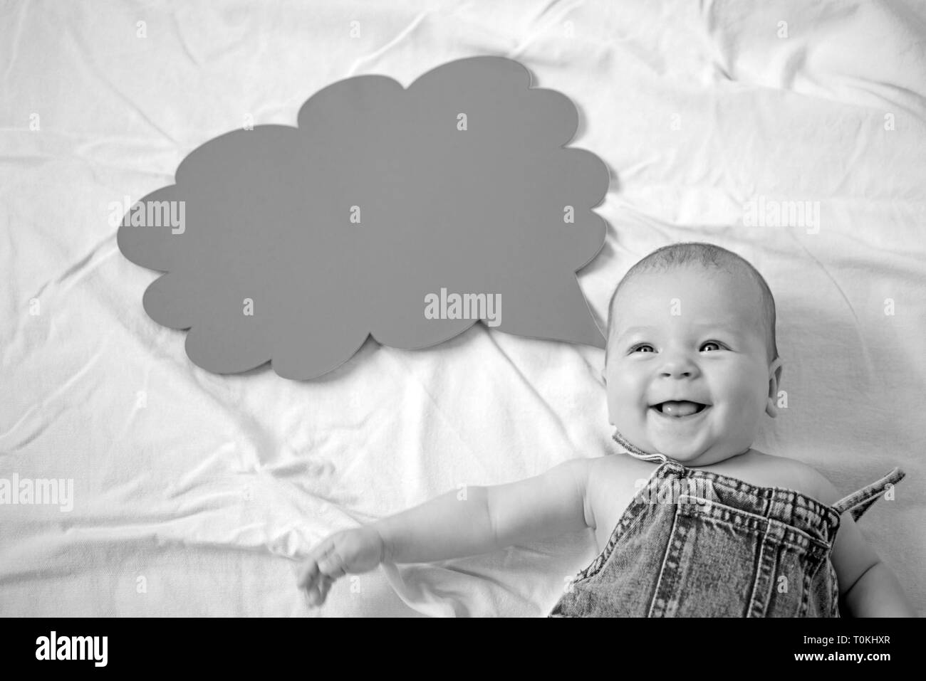 I am so happy. Portrait of happy little child. Sweet little baby. New life and birth. Family. Child care. Childrens day. Small girl. I can speak. Word - Stock Image
