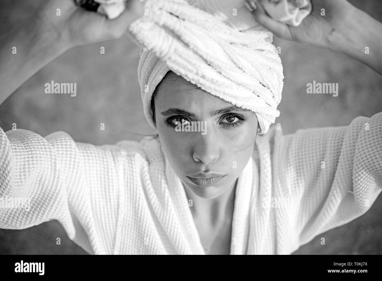 Hair care. Skincare model after spa bath. Skincare at spa. Beauty salon. Beauty routine and hygiene care. Bathing habits. Young woman in bathing gown - Stock Image