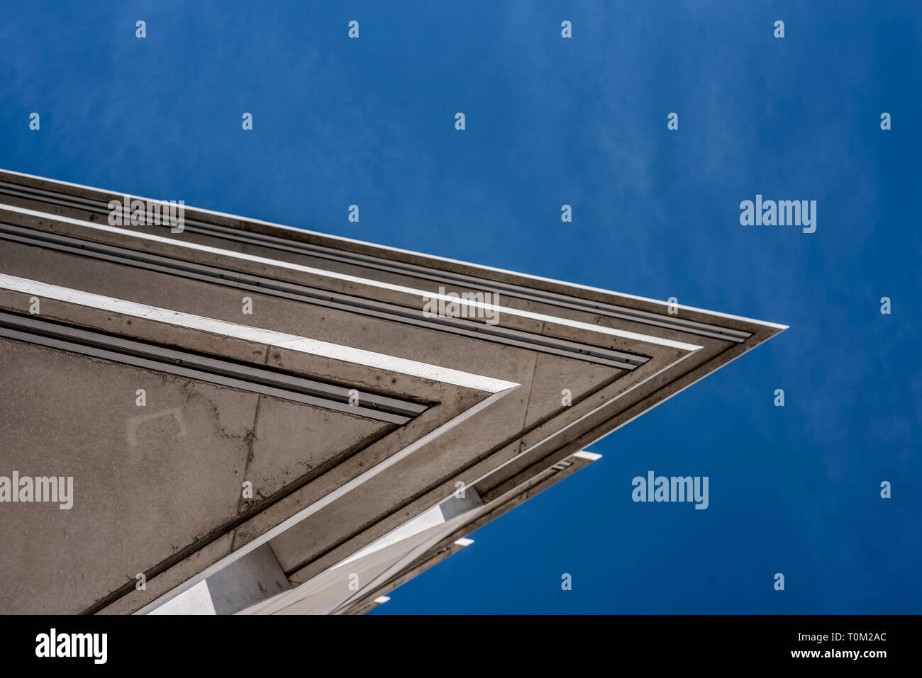 futuristic construction detail with acute-angle roof and balcony, imaginary fin shape - Stock Image