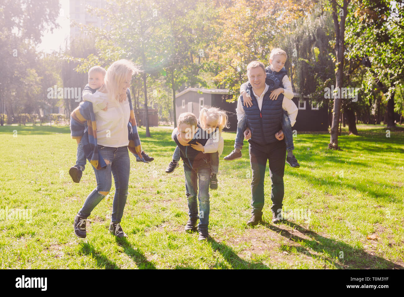 Theme family active leisure outside in nature. large Caucasian family with four children. Mom and Dad actively relaxing. enjoy life in park near house Stock Photo
