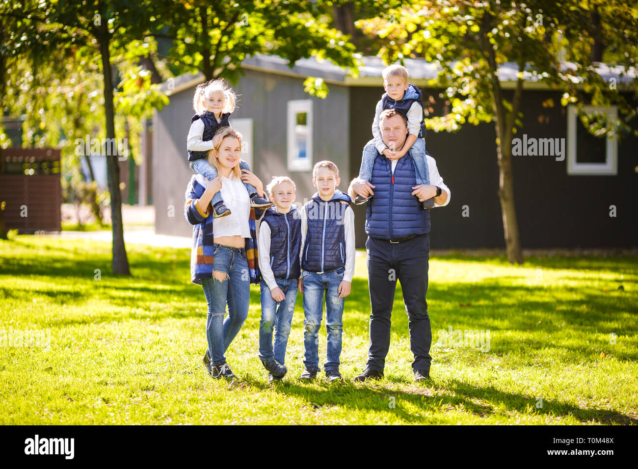 40b888e8278fa Theme family active leisure outside in nature. large Caucasian family with  four children. Mom and Dad actively relaxing. enjoy life in park near house