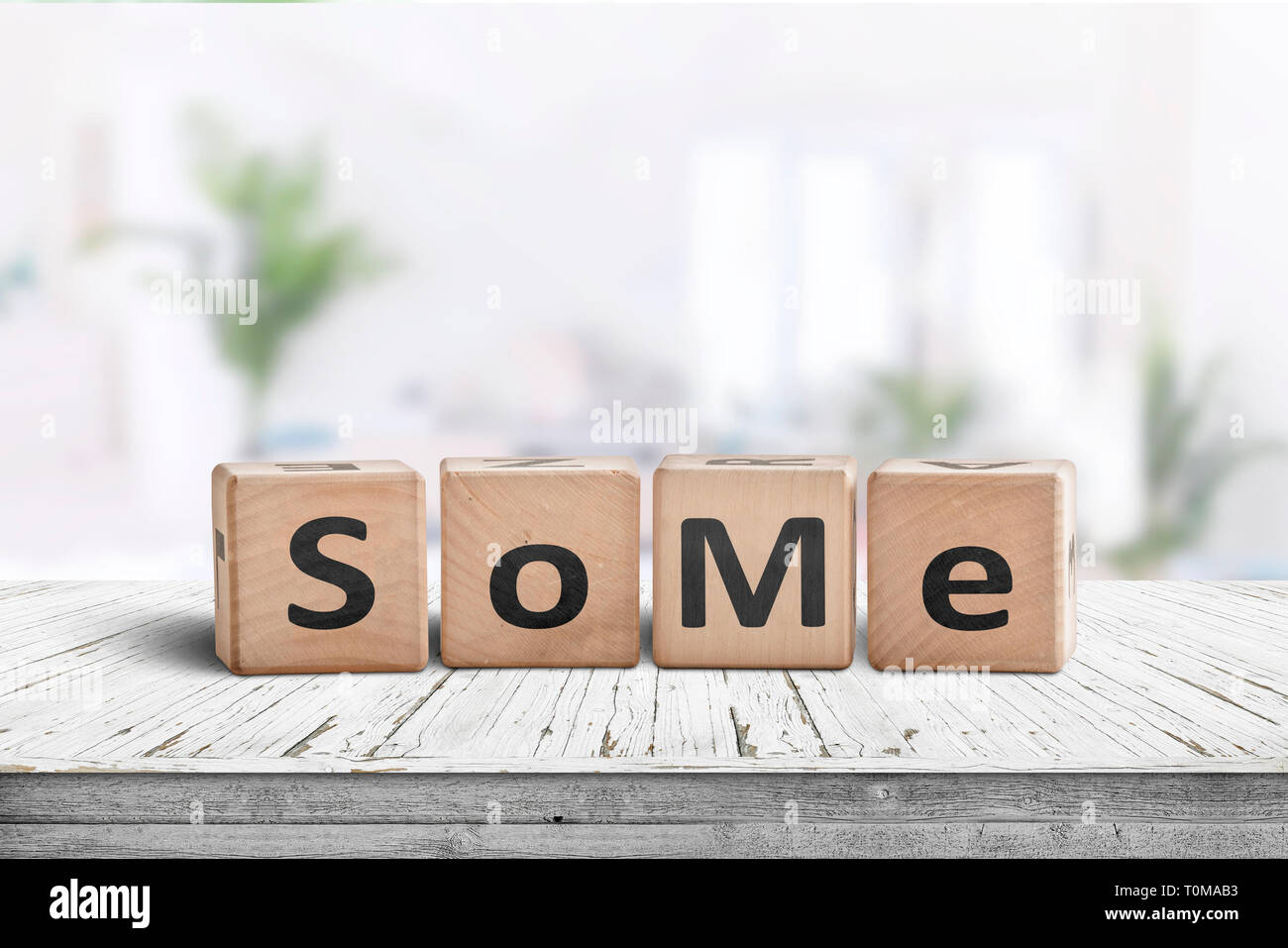 Social media slang word SoMe sign on a wooden table in a ...