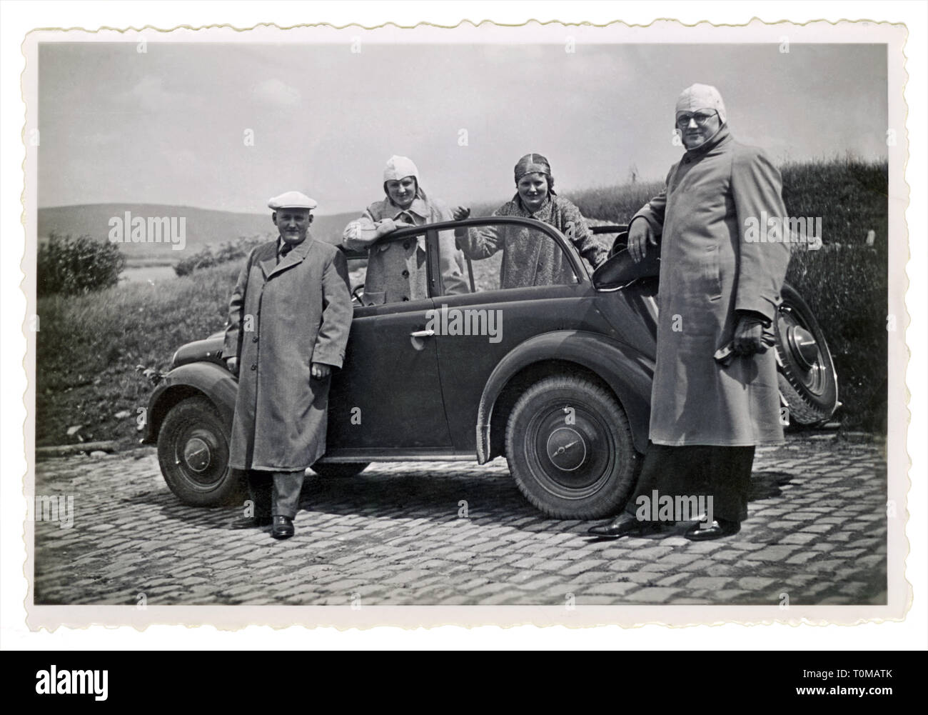 transport / transportation, car, Opel, Opel Olympia Cabrio, convertible, 24 horsepower, four-cylinder, 1288 cubic centimetre cylinder capacity, maximum speed 95 km / h, four-seater, two-door model, self-supporting all-steel body, Whitsun excursion, two couples, men, women, posing with car, Germany, Bodenfelde, Lower Saxony, Whitsun 1936, Additional-Rights-Clearance-Info-Not-Available - Stock Image