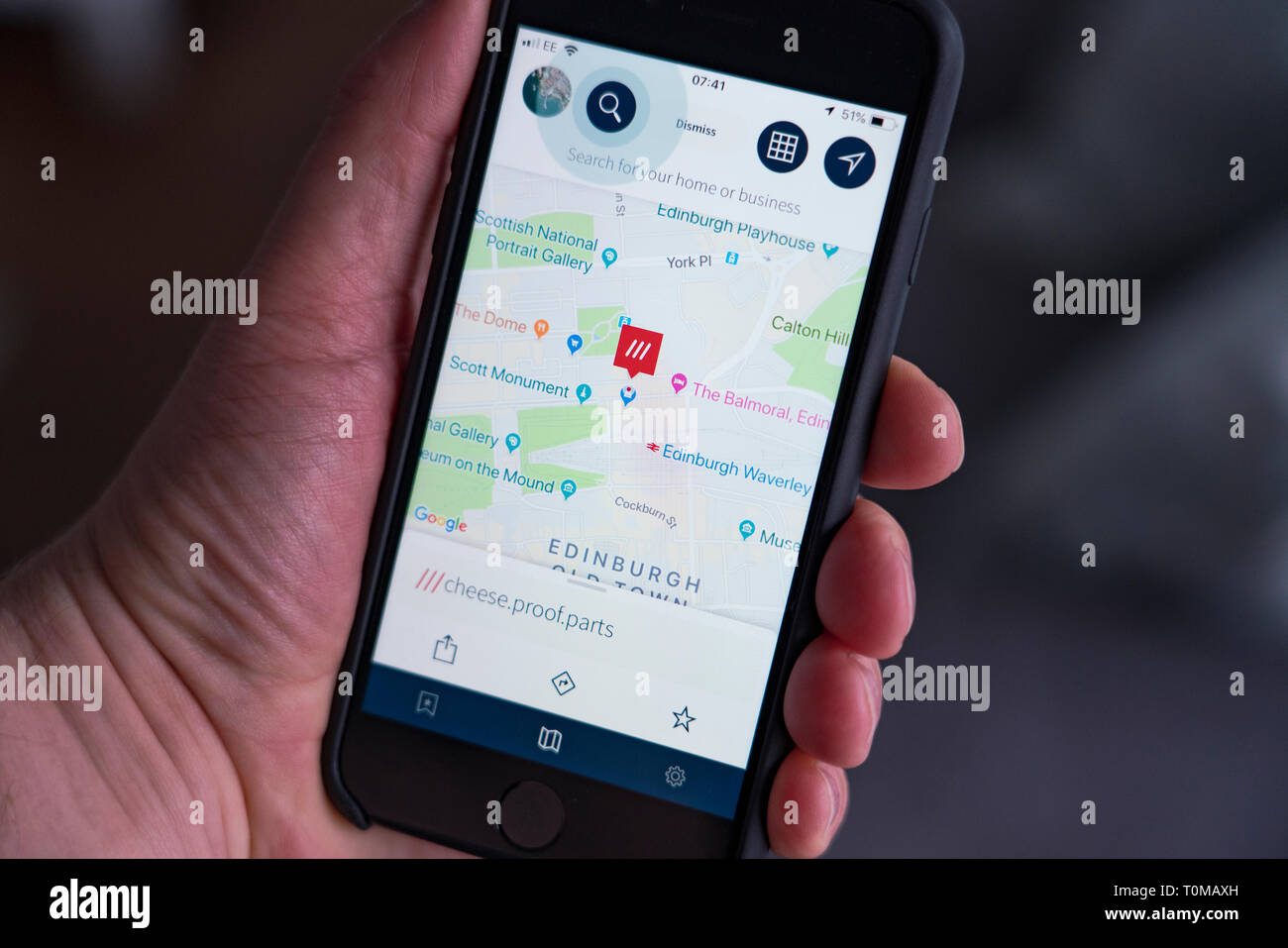 Person using What3words app on phone to locate position  The