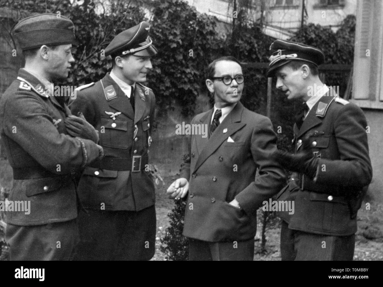 Second World War / WWII, aerial warfare, pilots of the German Luftwaffe (German Air Force) and a civilian, Paris, March 1943, Additional-Rights-Clearance-Info-Not-Available - Stock Image
