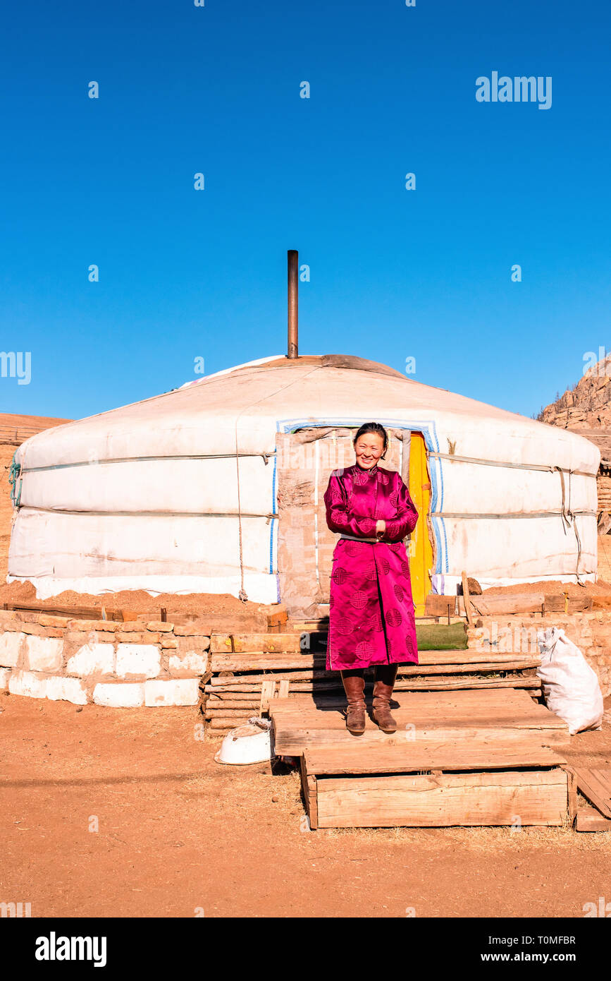 Nomadin in front of yurt in Mongolia Stock Photo