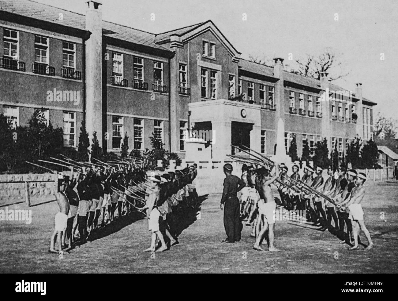Students of Tongyeong Elementary School practicing Kendo as one of military training,Gyeongnam Province, 1942, Private Collection - Stock Image