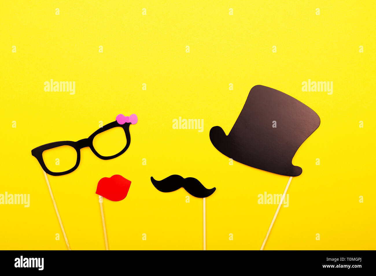 Male and female photo booth props on the yellow background  Wedding