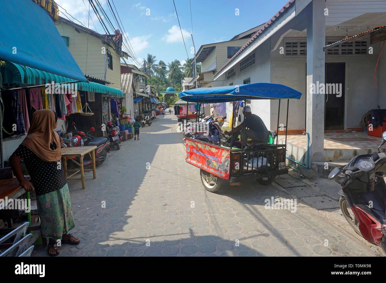 People on a street at fishing village Hua Thanon, Koh Samui, Gulf of Thailand, Thailand - Stock Image