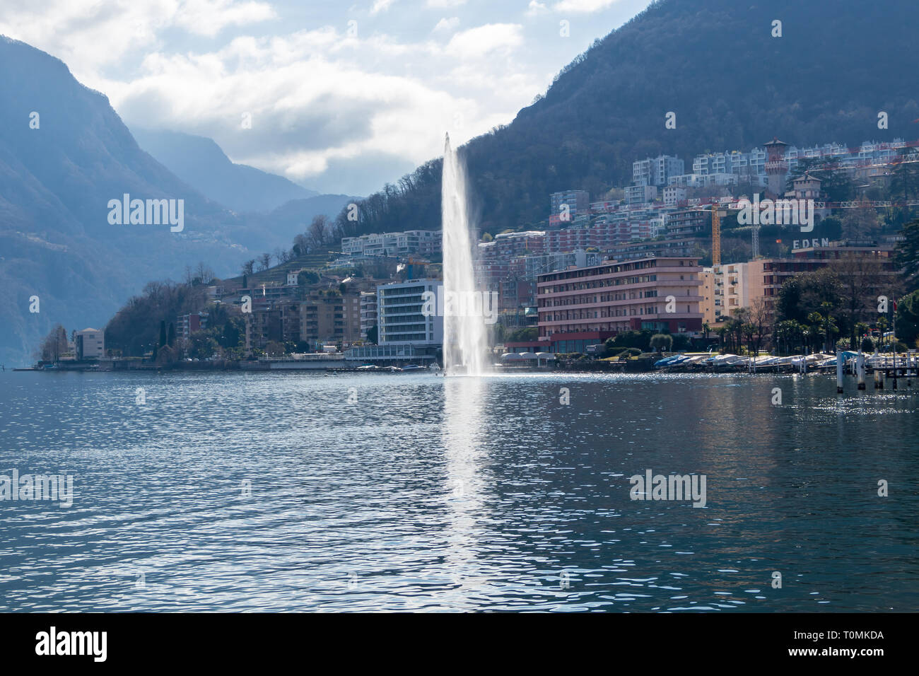 View of central Lugano with lake and fountain in March Stock Photo