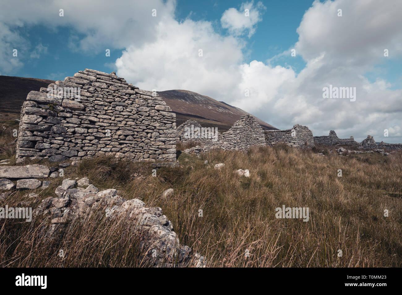 Deserted village in Western Ireland, Slievemore, Achill Island, Ireland - Stock Image