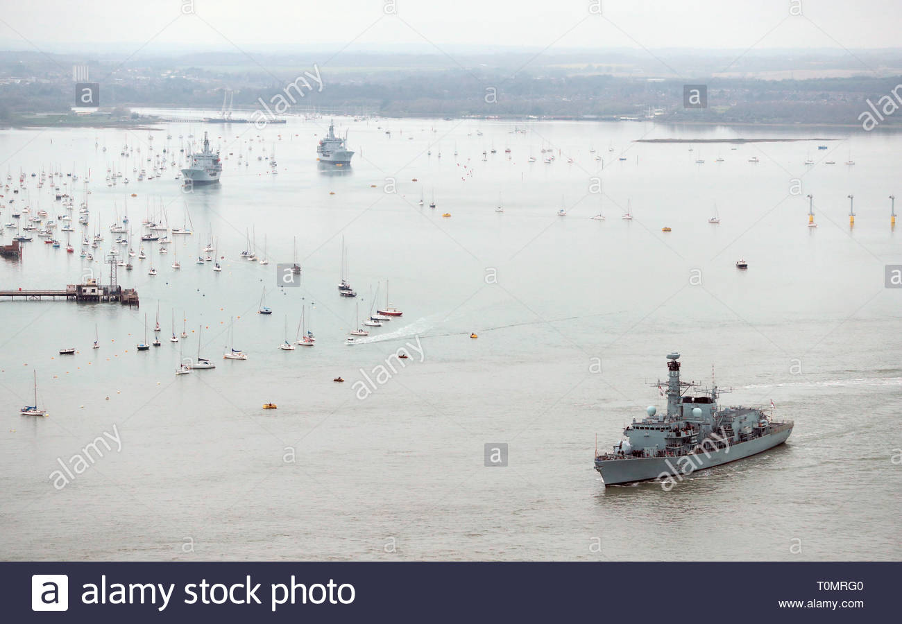 Royal Navy Type 23 frigate HMS Northumberland leaves HMNB Portsmouth as she make's her way out to sea. - Stock Image