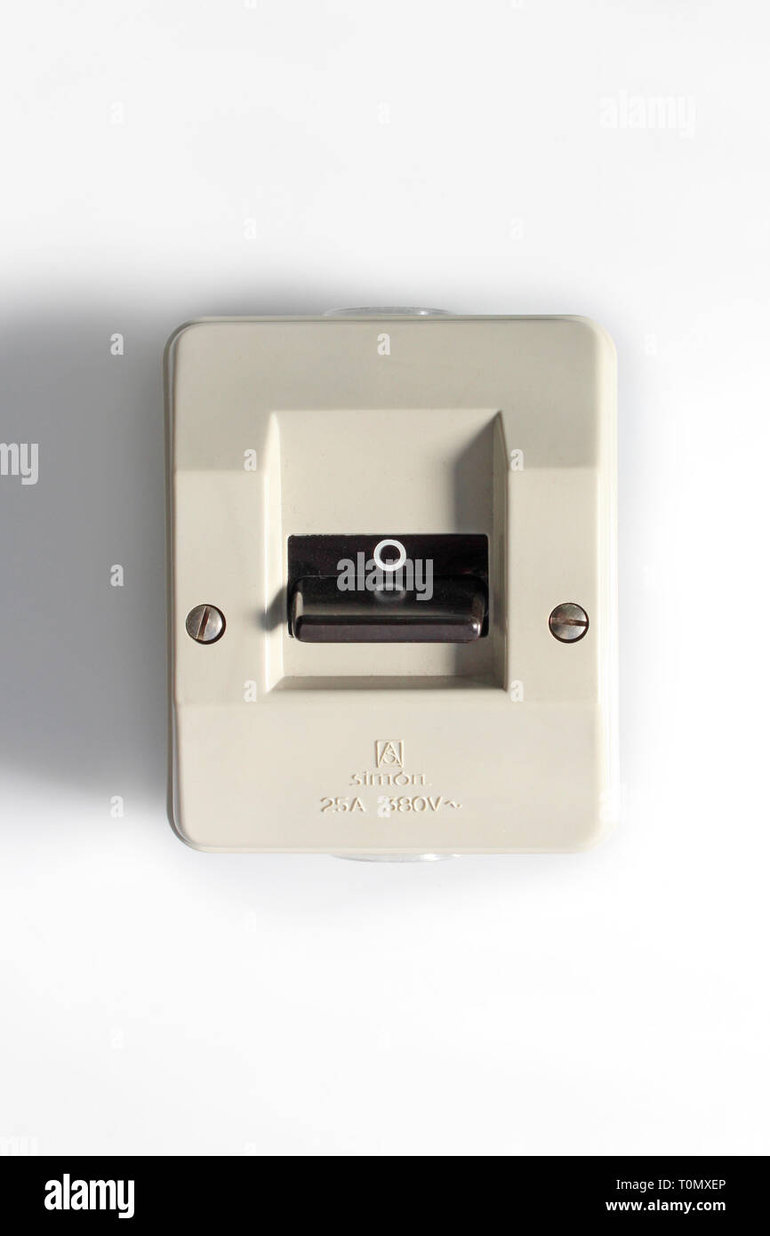 Vintage power switch on off, isolated on white background, close-up - Stock Image