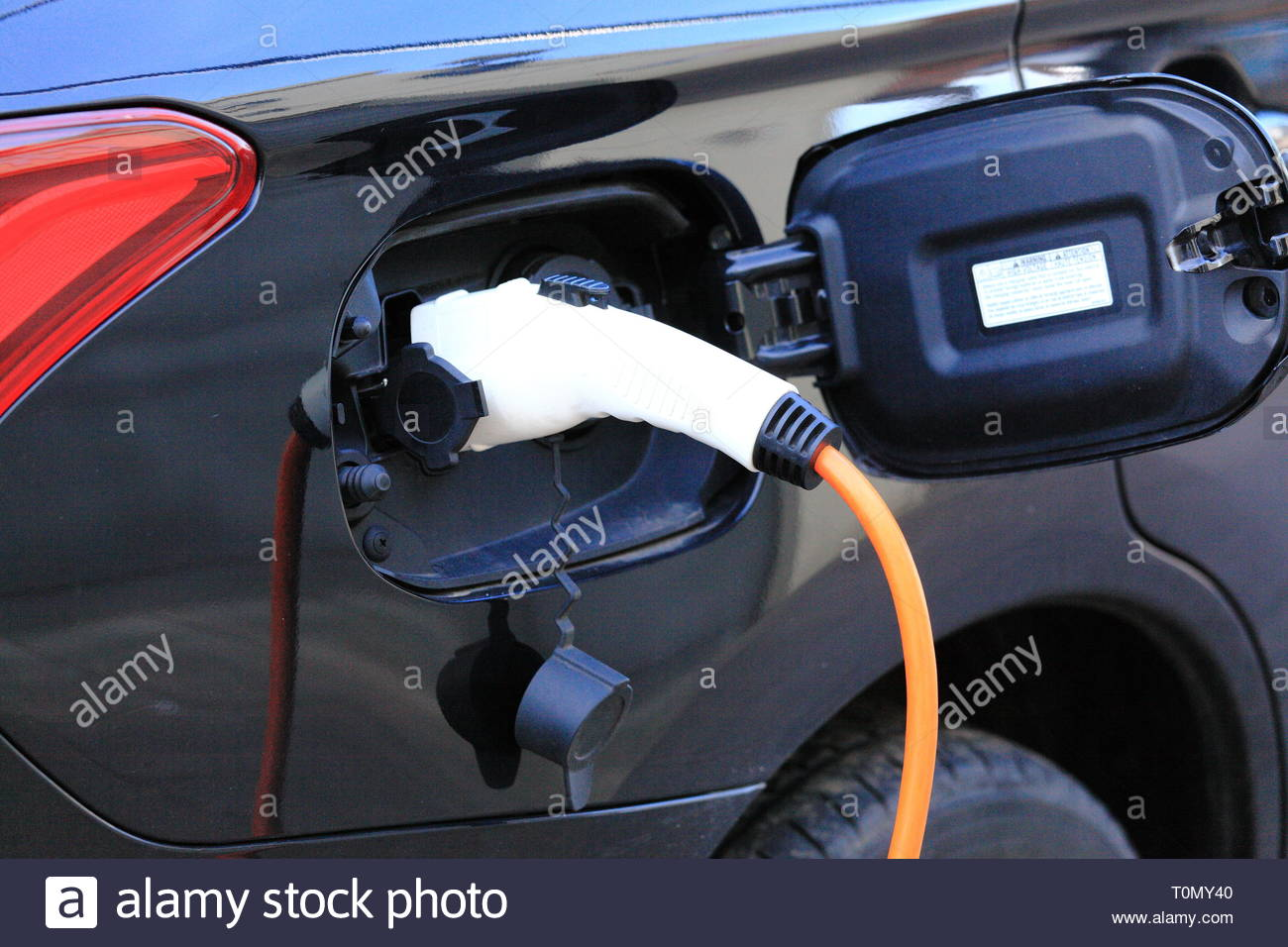 A car charging at an electric charting meter point at Stockport UK - Stock Image