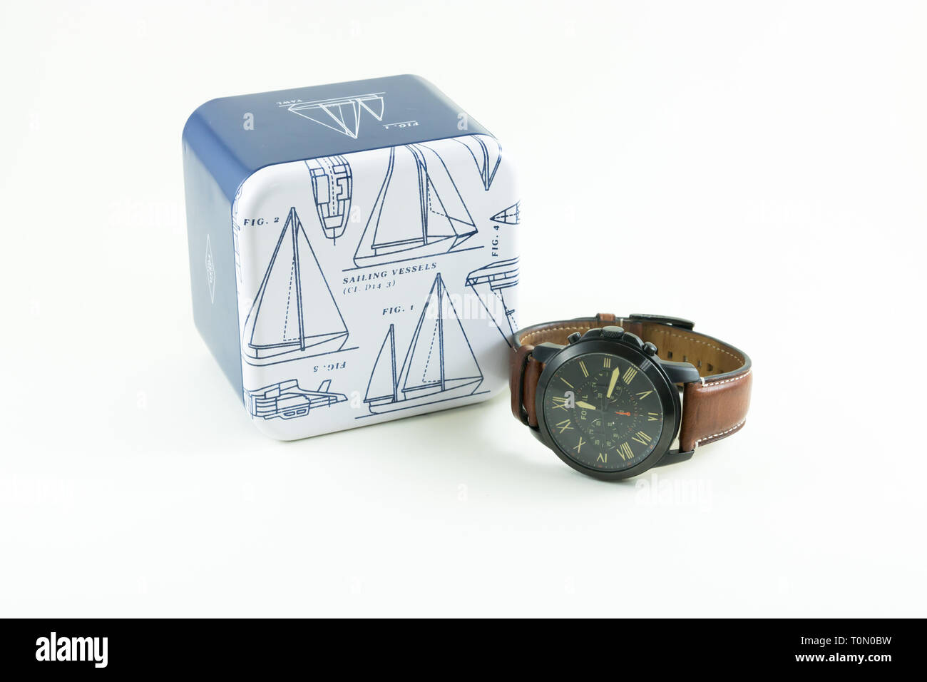 Photo of Fossil men watch isolated on a white background. Fossil Group, Inc. is an American fashion designer and manufacturer of watches. - Stock Image