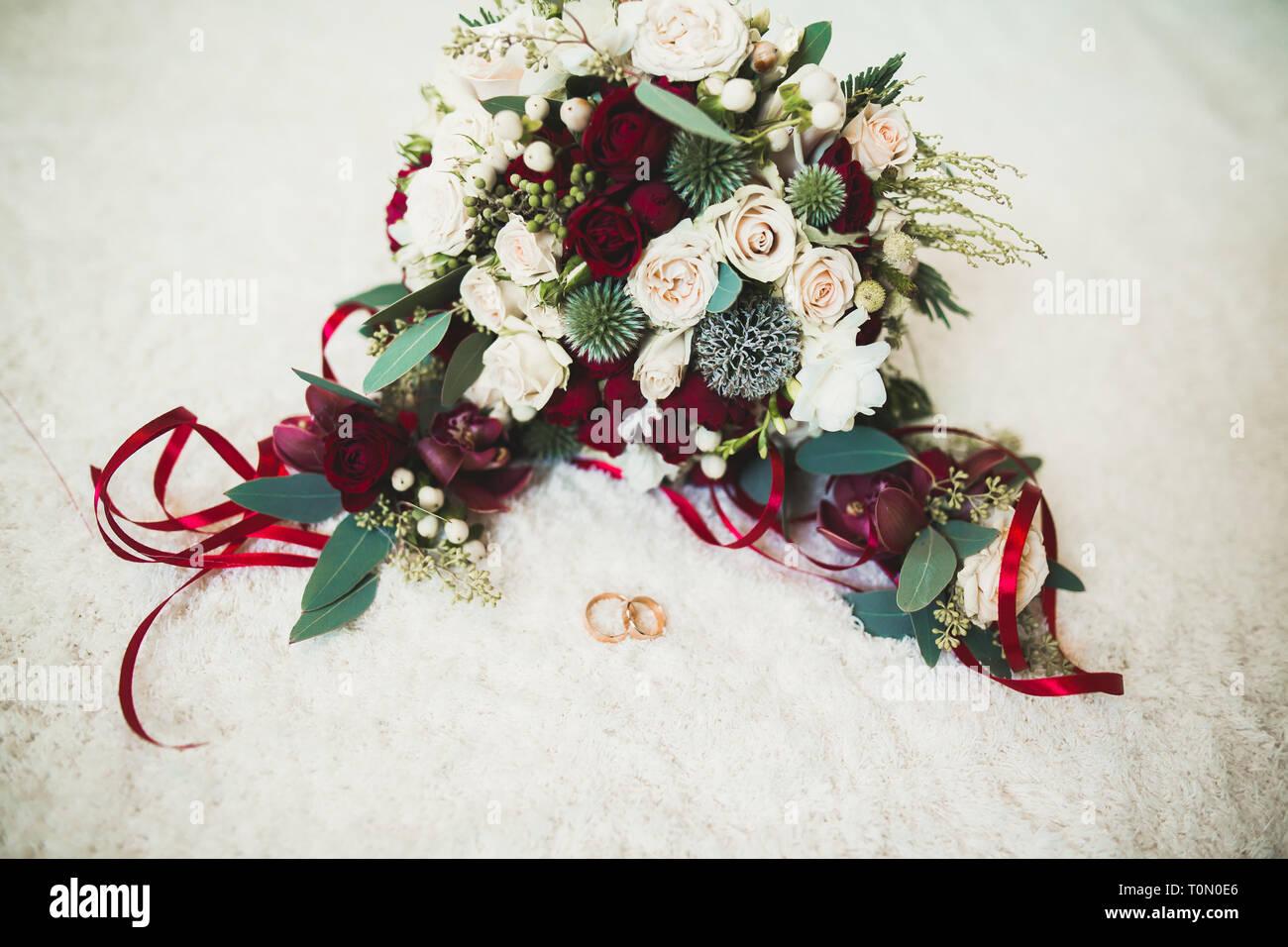 Close-up of wedding rings on beautiful background. - Stock Image