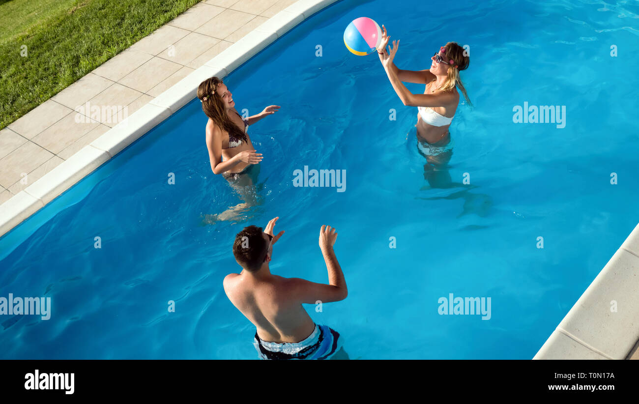 Friends playing ball games in pool Stock Photo: 241407134 ...