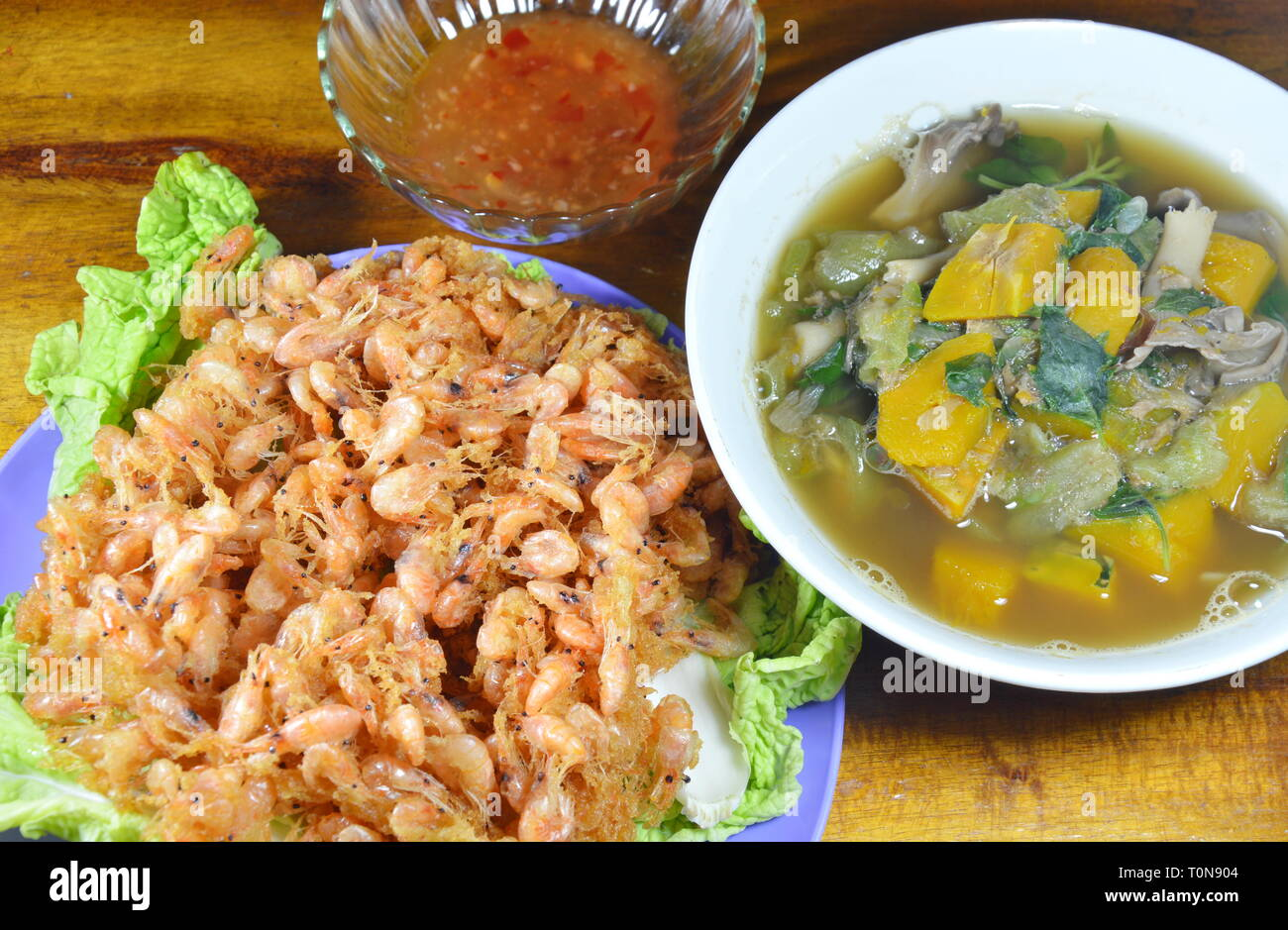 batter-fried shrimp and spicy mixed vegetable soup - Stock Image