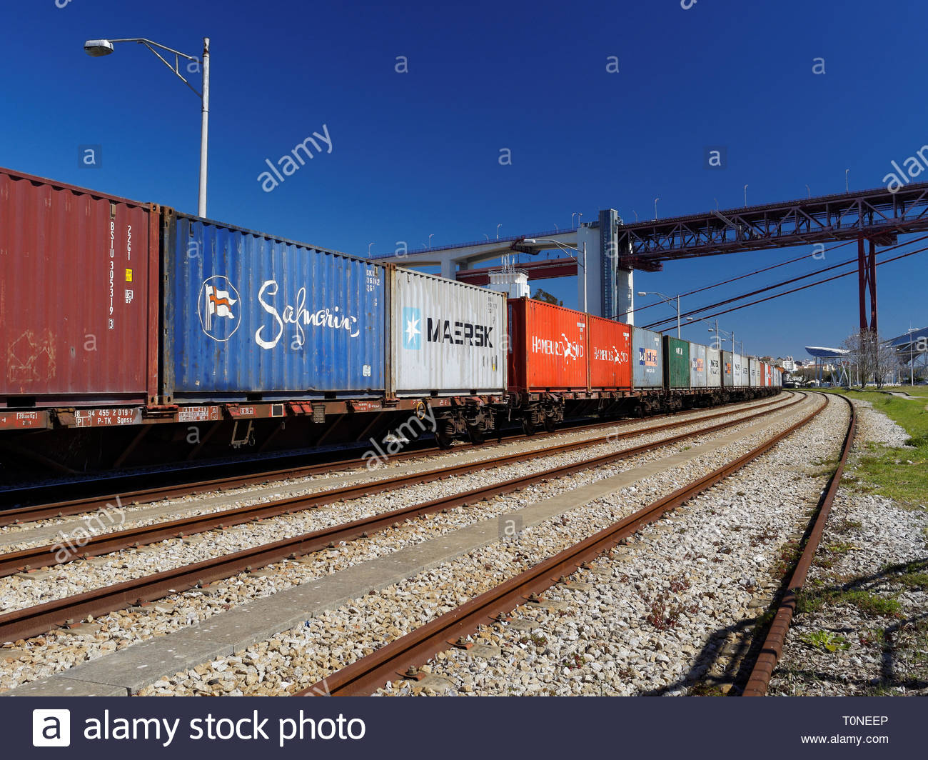 Metal shipping containers loaded on rail stock, Lisbon, Portugal - Stock Image
