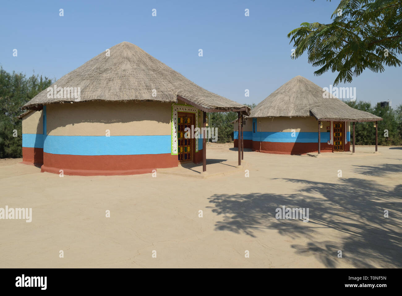 Bunga-Cylindrical mud house with thatched roof in Kutch,Gujarat, India - Stock Image