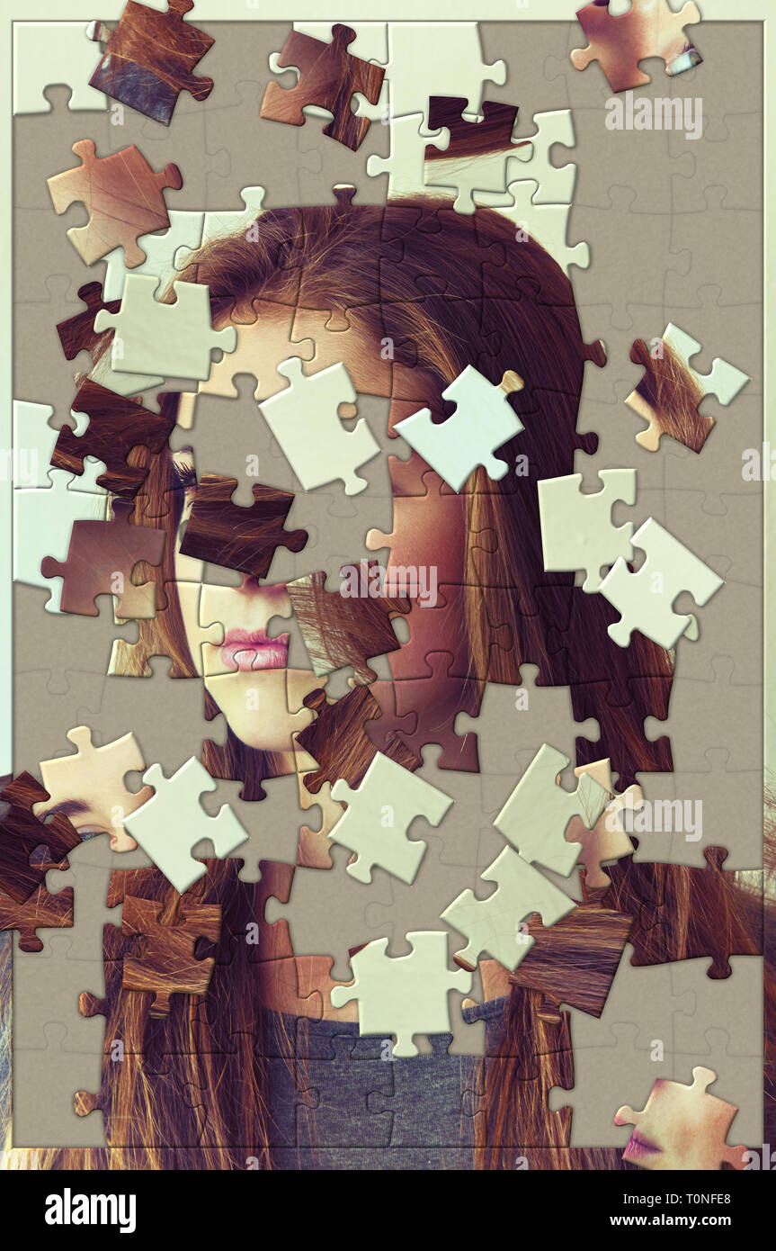 unfinished jigsaw puzzle with scattered pieces, of a woman face, psyche, psychology and shattered personal identity concept - Stock Image