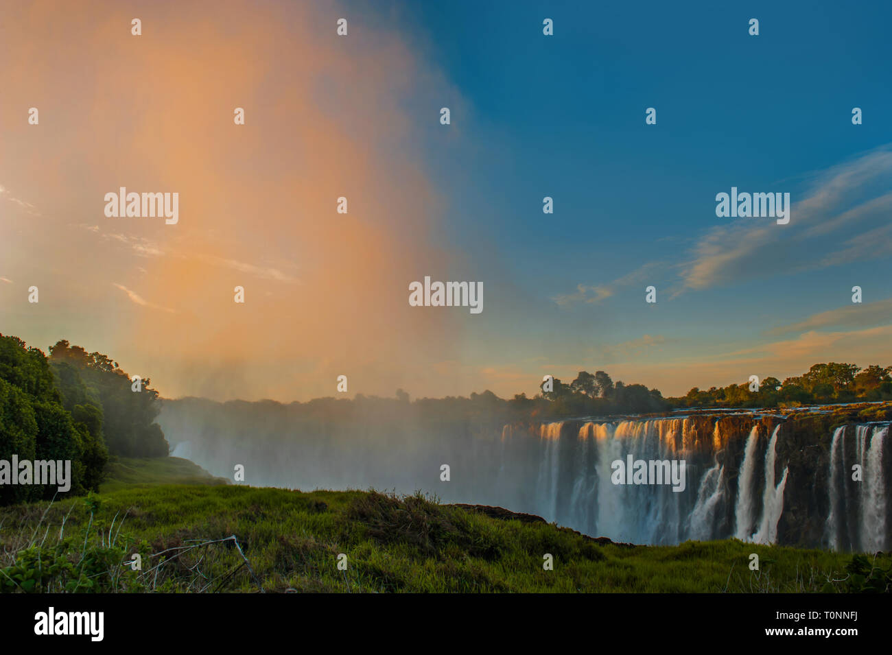 Victoria Falls Sunset Waterfall Mist Wall - Stock Image