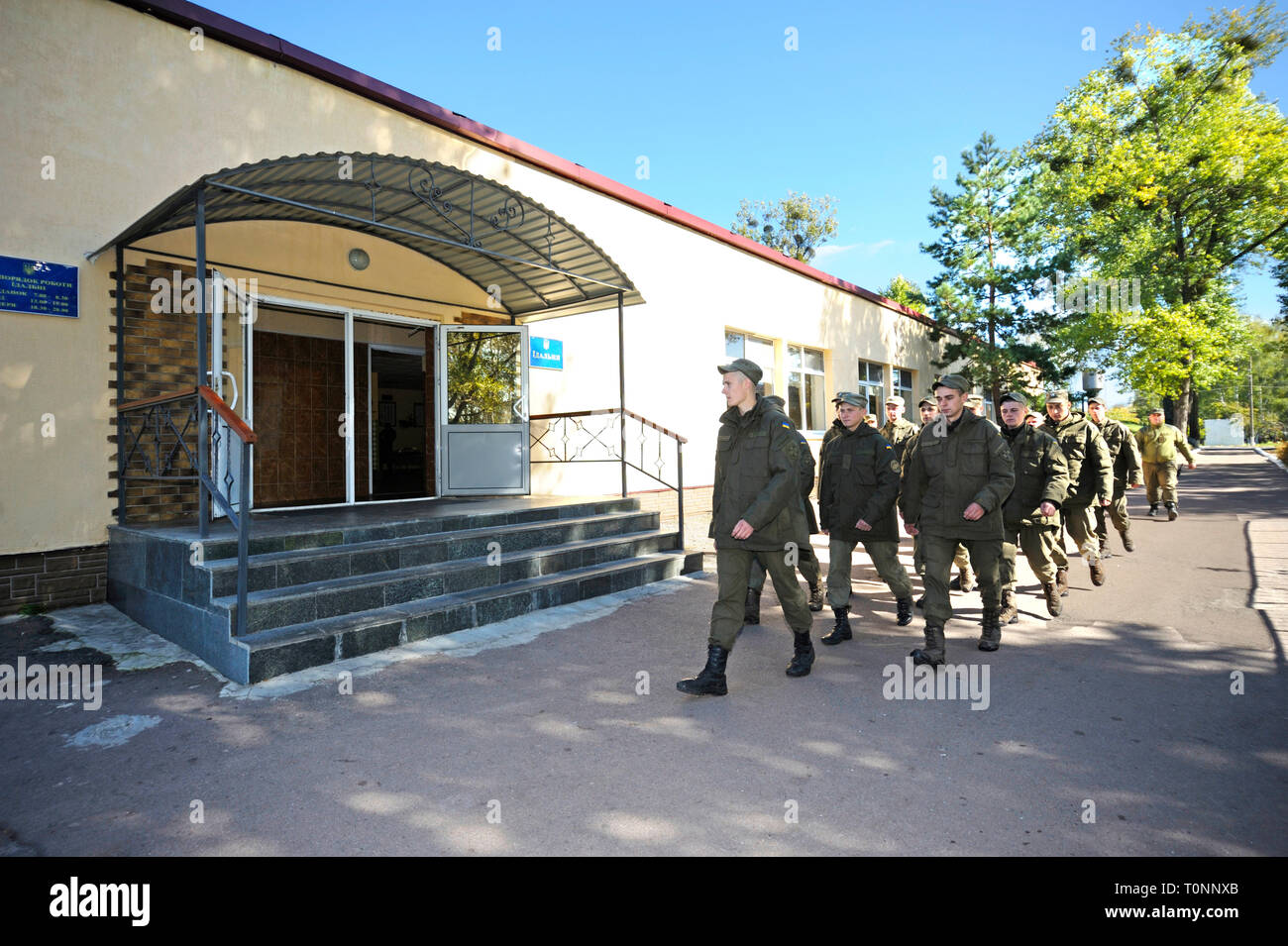 Unit of soldiers coming up to a chow hall for dinner. Novo-Petrivtsi military base, Ukraine. November 12, 2018 - Stock Image