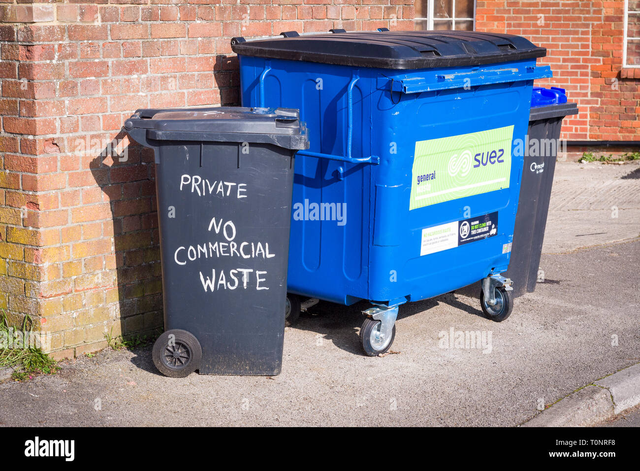 Waste recycling bins for private and business users await emptying in Devizes Wiltshire England UK Stock Photo
