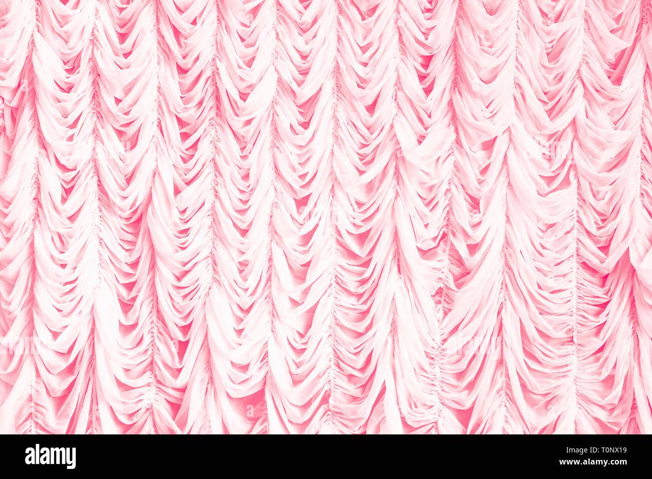 Coral tulle on window. Interior design. Stock Photo