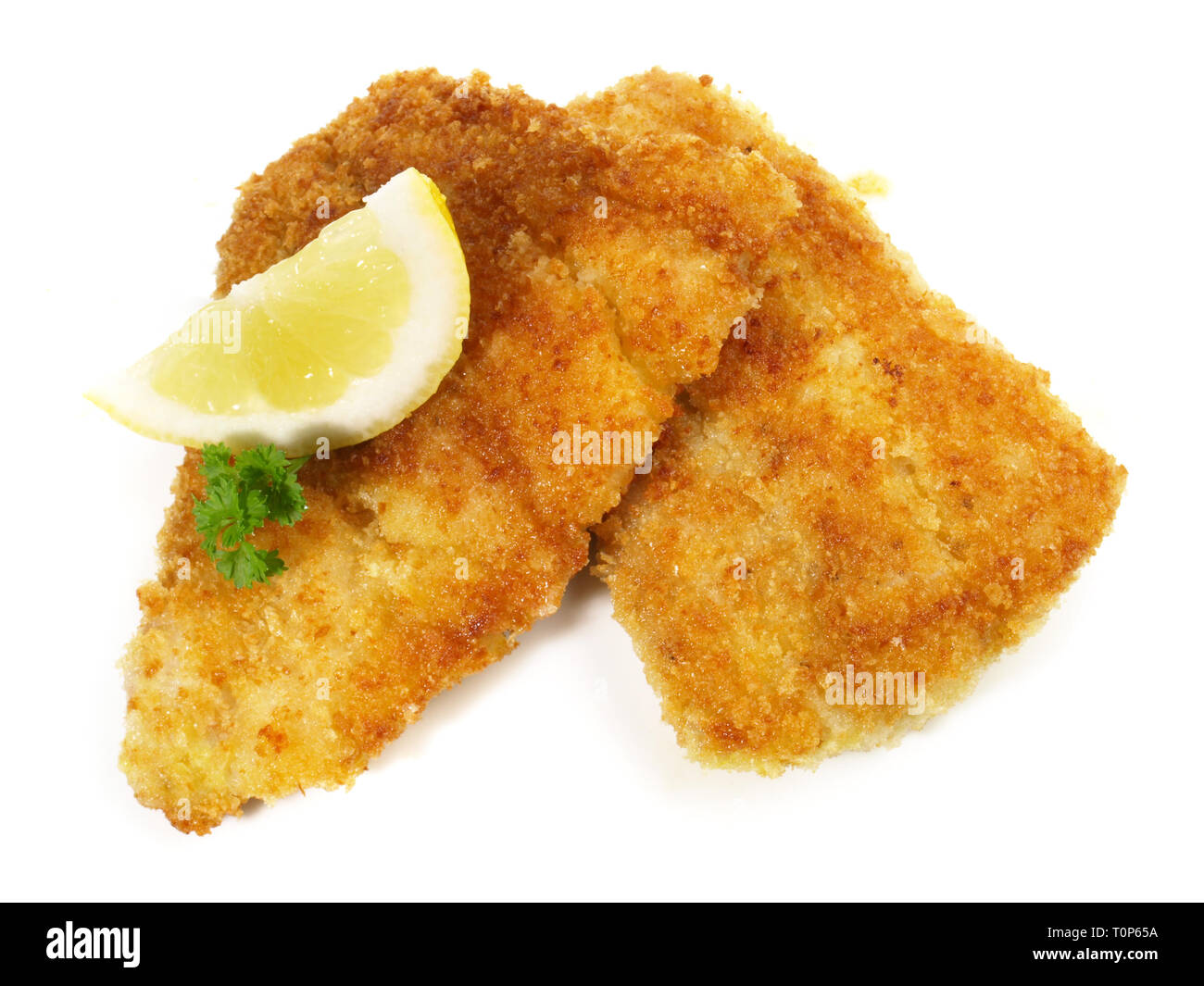Fried Pollack Fish in breadcrumb coating on white Background - Stock Image