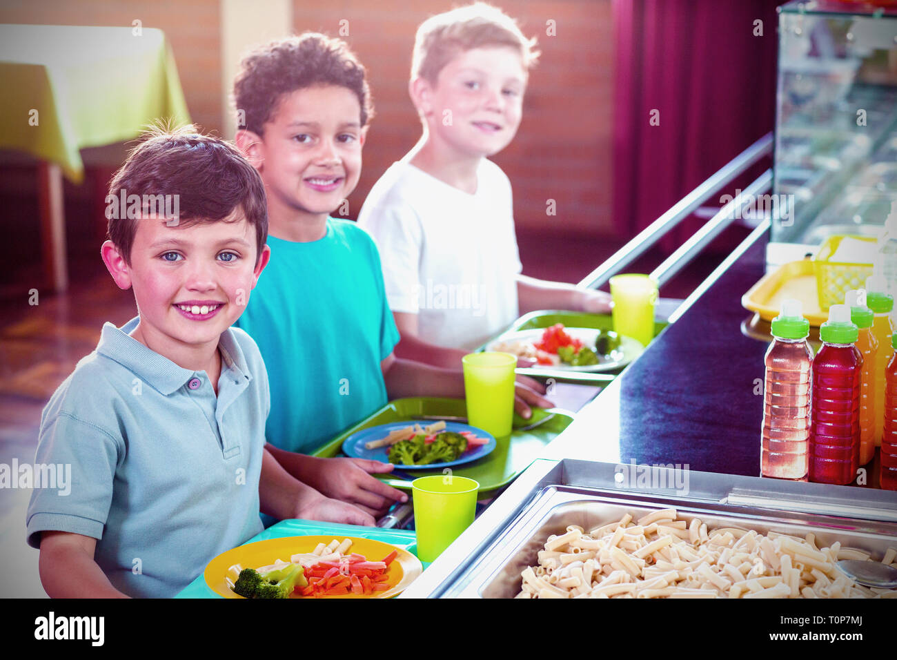 Schoolboys standing near counter Stock Photo
