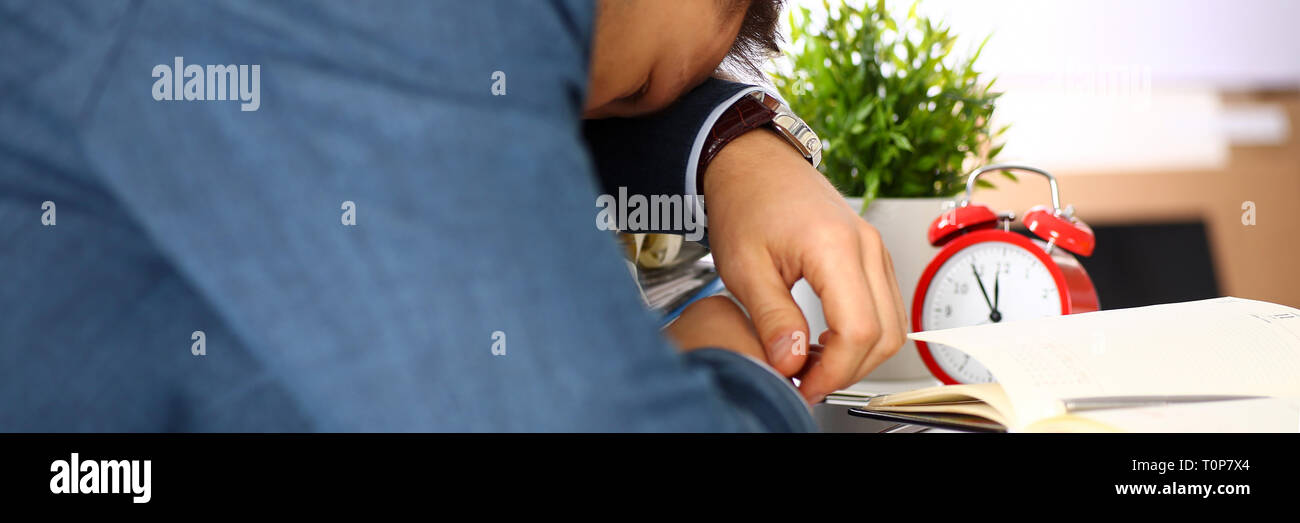 Tired office male clerk in suit take nap - Stock Image
