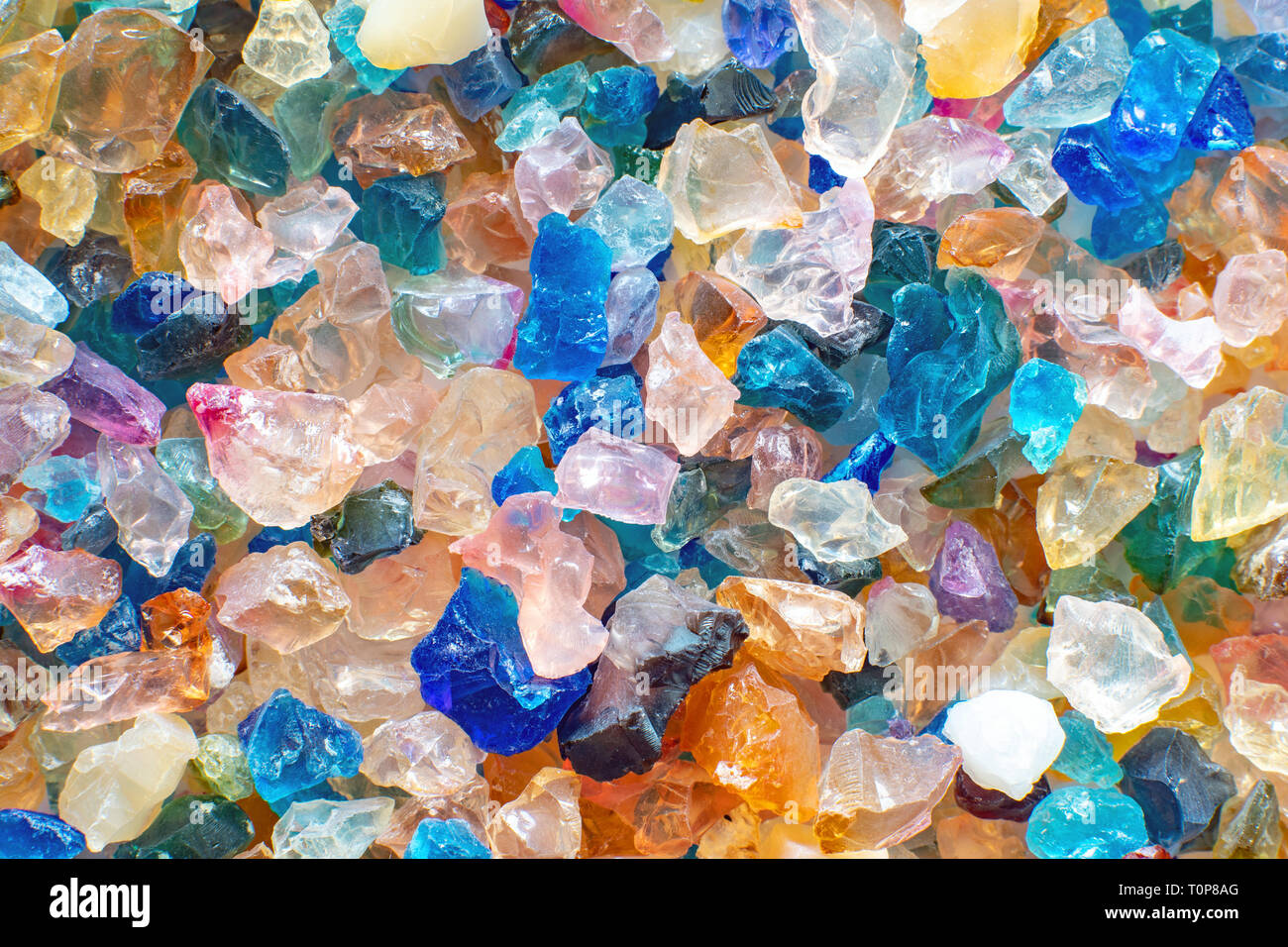 Small shiny colorful stones as a background pattern Stock Photo