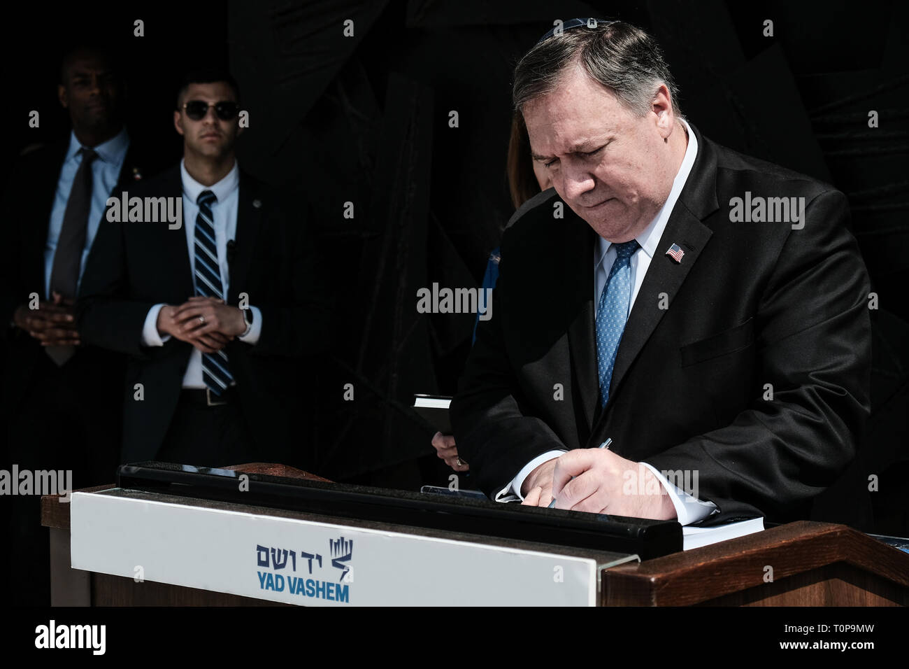 """Jerusalem, Israel. 21st March, 2019. Secretary of State of the United States of America, MICHAEL MIKE POMPEO (R), visits Yad Vashem World Holocaust Remembrance Center touring the """"Flashes of Memory - Photography during the Holocaust"""" exhibition, partaking in a memorial ceremony in the Hall of Remembrance and signing the guest book. Pompeo's visit to Israel comes ahead of a meeting between Trump and Netanyahu planned for 25th March, 2019, in Washington, perhaps signaling the U.S. Credit: Nir Alon/Alamy Live News Stock Photo"""