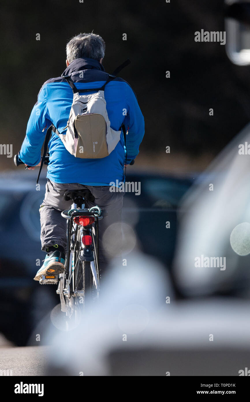 21 March 2019, Baden-Wuerttemberg, Nürtingen: A man rides a bicycle. On 21 March, Baden-Württemberg's Minister of Transport, Hermann, presented the results of ten years of cycling promotion by the state of Baden-Württemberg. Photo: Sebastian Gollnow/dpa - Stock Image