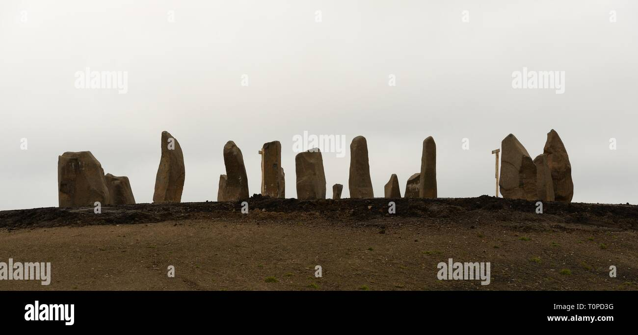 Sighthill, Glasgow, Scotland, UK. 21st Mar, 2019. UK Weather. A grey sky was the backdrop to the newly re-erected standing stones in Sighthill. A mild, still and overcast day with temperatures around 12 degrees centigrade for the first day after the spring equinox. Credit: Douglas Carr/Alamy Live News - Stock Image