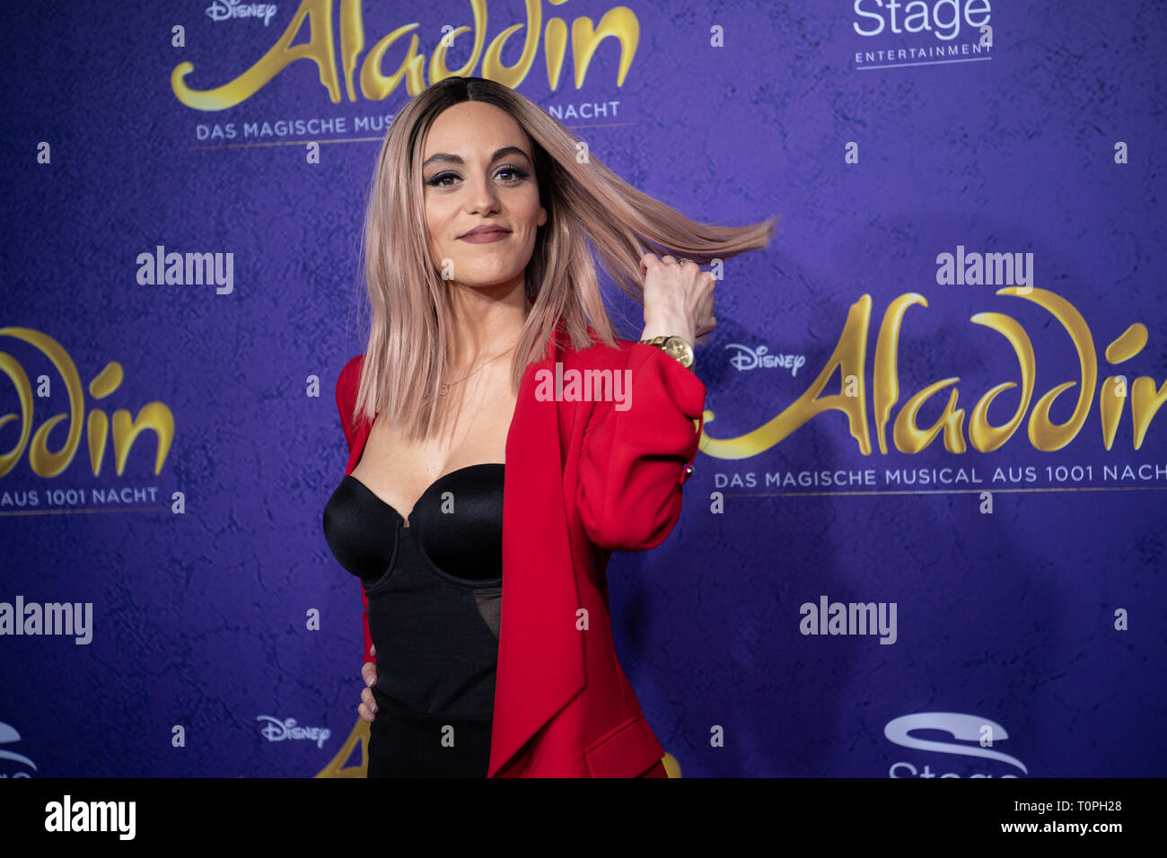 Stuttgart, Germany. 21st Mar, 2019. Jenny Marsala, singer, comes over the red carpet to the premiere of the musical 'Aladdin'. The musical was previously shown in Hamburg. Credit: Fabian Sommer/dpa/Alamy Live News - Stock Image
