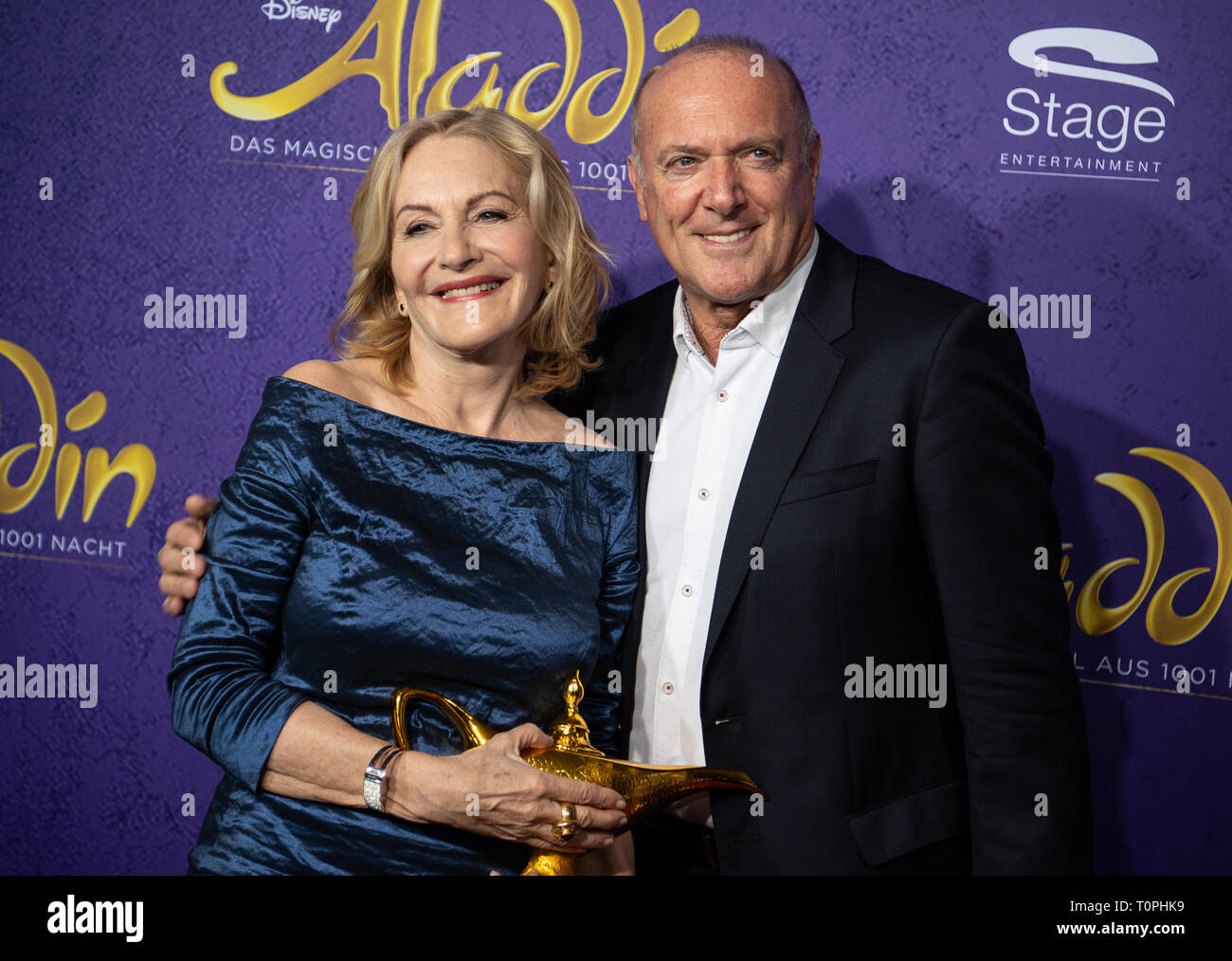 Stuttgart, Germany. 21st Mar, 2019. Gaby Hauptmann, writer, and Josef Schmidbauer come over the red carpet to the premiere of the musical 'Aladdin'. The musical was previously shown in Hamburg. Credit: Fabian Sommer/dpa/Alamy Live News - Stock Image