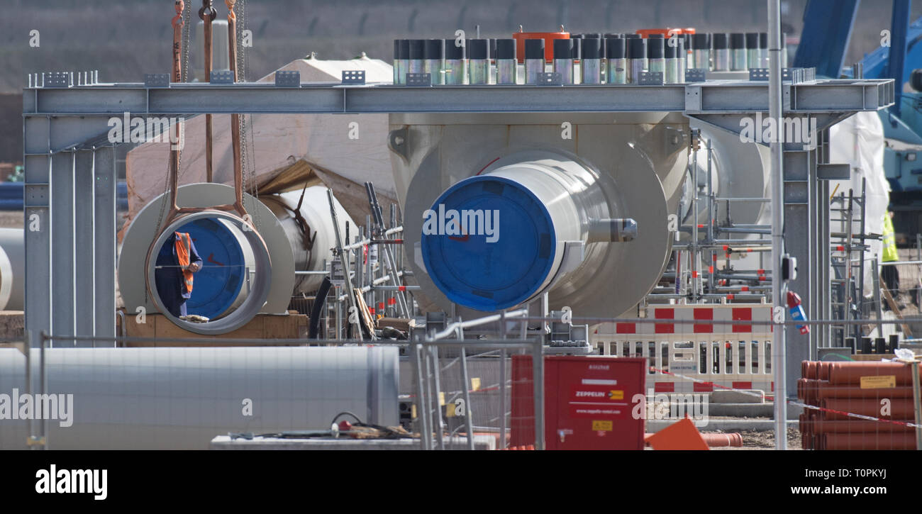 Lubmin, Germany. 19th Mar, 2019. View of the construction site of the receiving station of the Baltic Sea pipeline 'Nord Stream 2' near Lubmin. The 1,200-kilometer-long gas pipeline will transport around 55 billion cubic meters of Russian natural gas from Russia to Germany every year. The first Russian natural gas is expected to flow through the Nord Stream 2 Baltic Sea pipeline at the end of the year. So far, a third of the cables have been laid. Work in Germany is concentrated on the landing site near Lubmin. Credit: Stefan Sauer/dpa/Alamy Live News - Stock Image