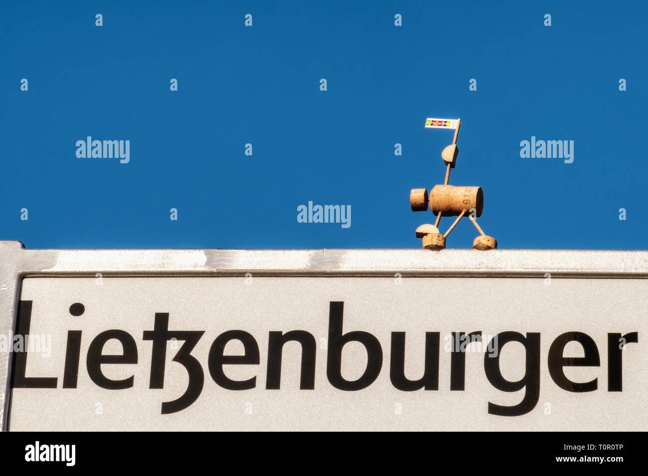 Berlin-Wilmersdorf. Lietzenburger street sign, Road sign with miniature Cork Yogi - Stock Image