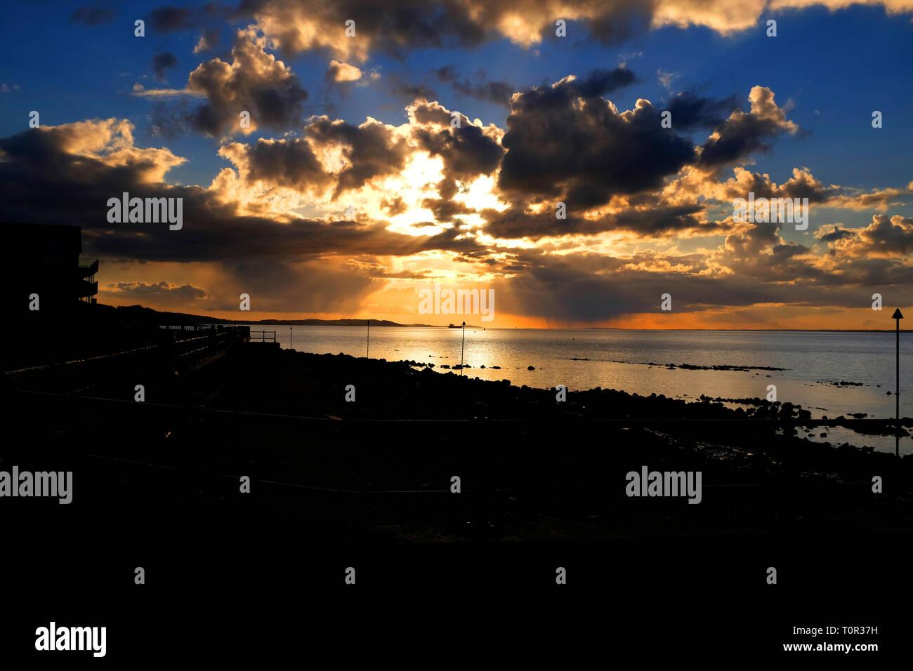 dramatic,sunset,over,sea,clouds,light,beams,Gurnard,Isle of Wight, England, UK, - Stock Image