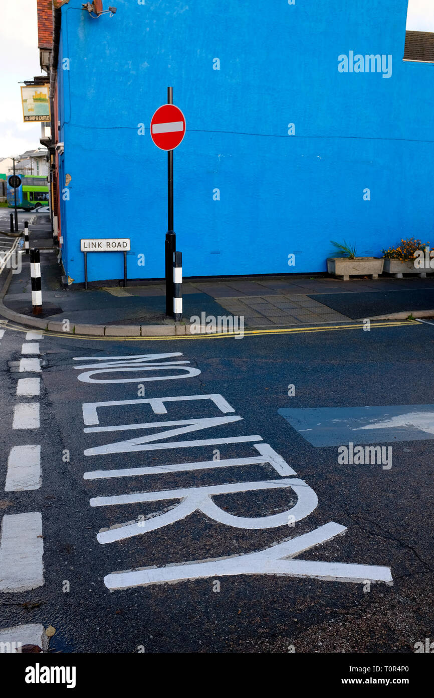 no,entry,sign,and,road,markings,blue,wall,graphic,colour,posterised,East,Cowes,Isle of Wight, England, UK, Stock Photo