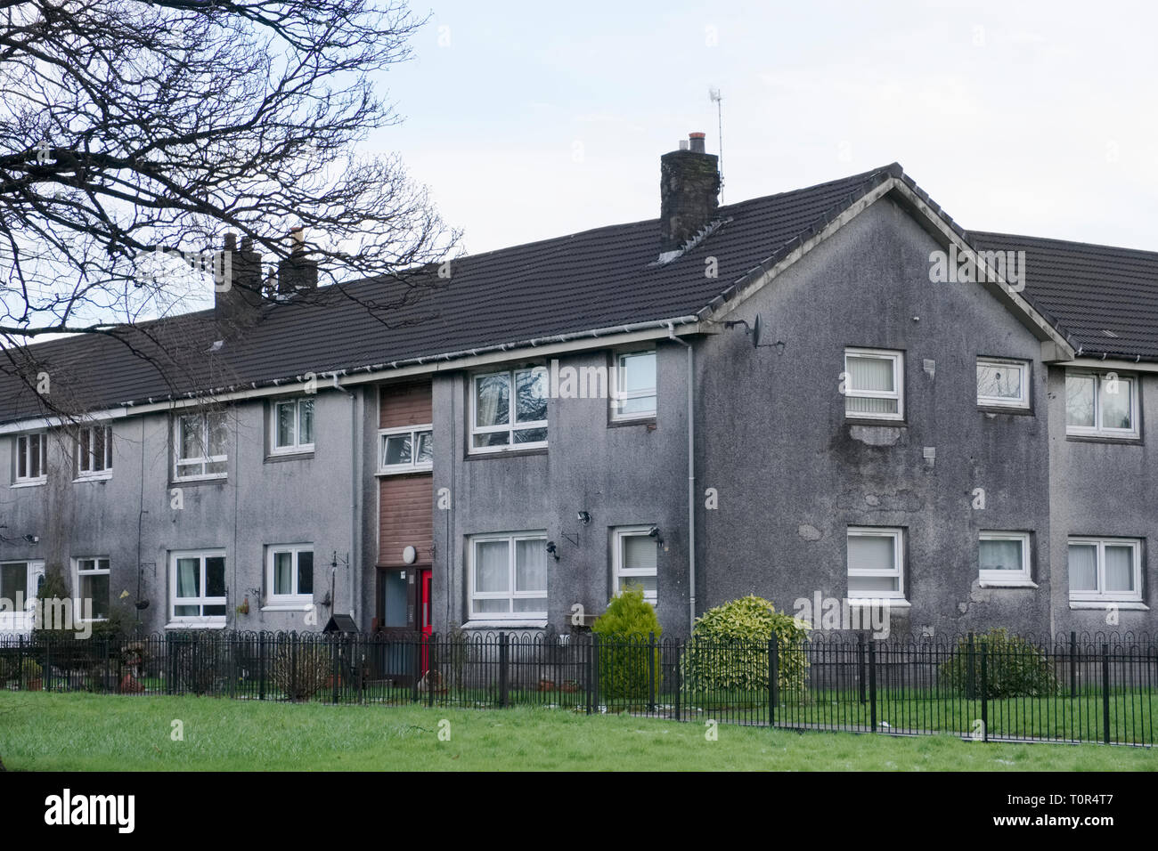 Poor council house for rent or for sale grey dark and dull Stock Photo