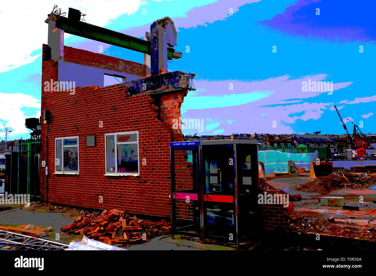 posterised,posterized,colour,treatment,partly,demolished,building,warehouse,factory,telephone,boxes,windows,bricks,steel,work,East,Cowes,Isle of Wight - Stock Image