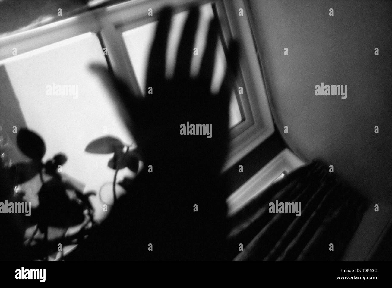 Hand,poised,to,slap,hit,punch,strike,defend,fight,guard,prevent,resist,avert,dispare,suicide,for,belt,impact,smash,spank,swipe,swat,wallop,punish,disc - Stock Image