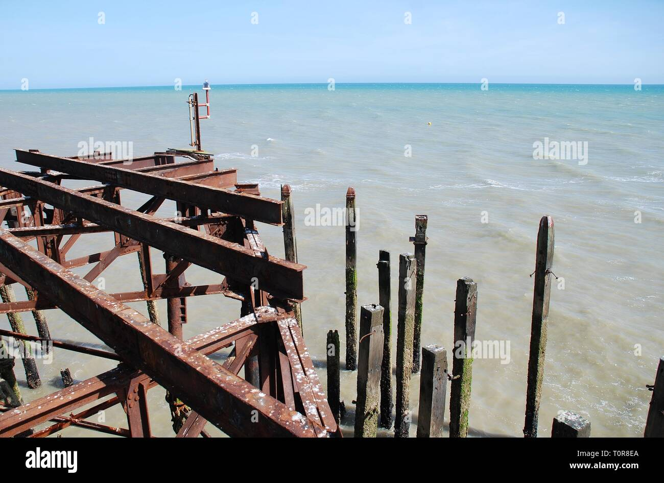 Weathered wooden posts and iron sub structure of the Victorian pier at Hastings in East Sussex, England on May 3, 2016. Stock Photo