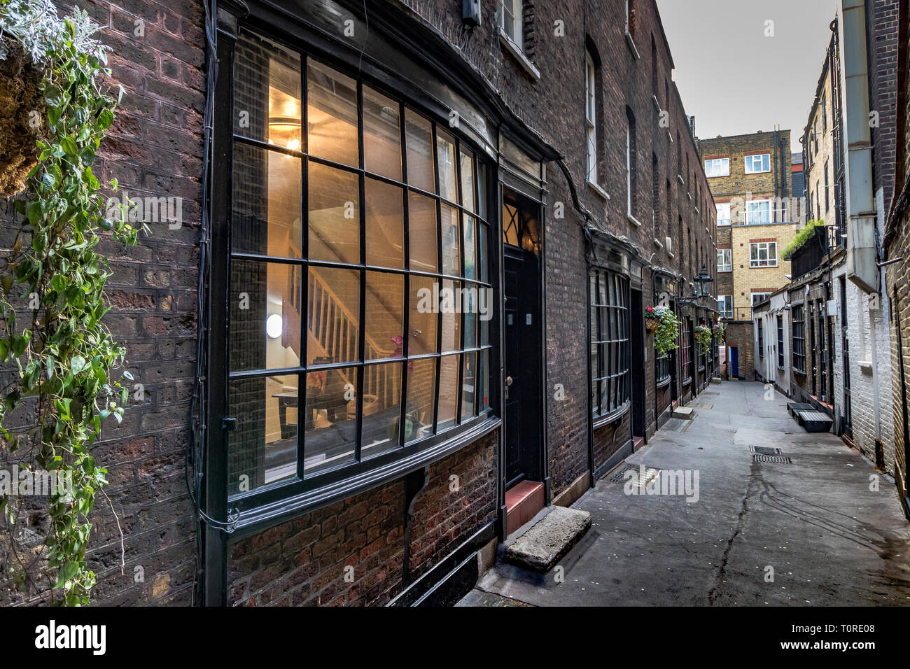 Bow-fronted houses in Goodwin's Court , Goodwin's Court is a narrow alley running between St. Martin's Lane and Bedfordbury  in London's West End - Stock Image