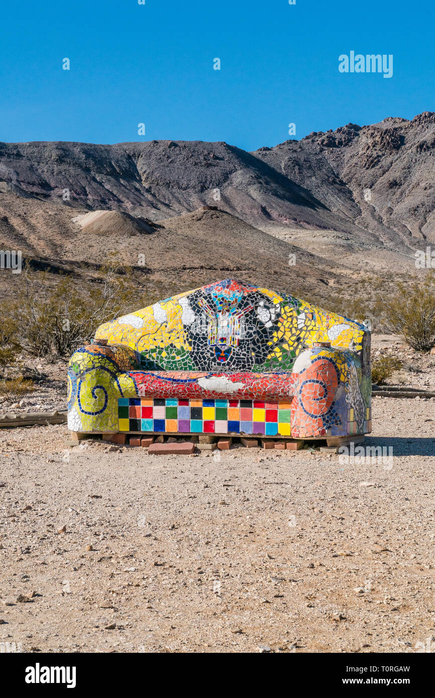 Mosaic Sofa sculpture by artist Sofie Steigmann located at the Goldwell Open Air Museum in Rhyolite, Nevada.  Rhyolite is a ghost town in Nye County,  - Stock Image