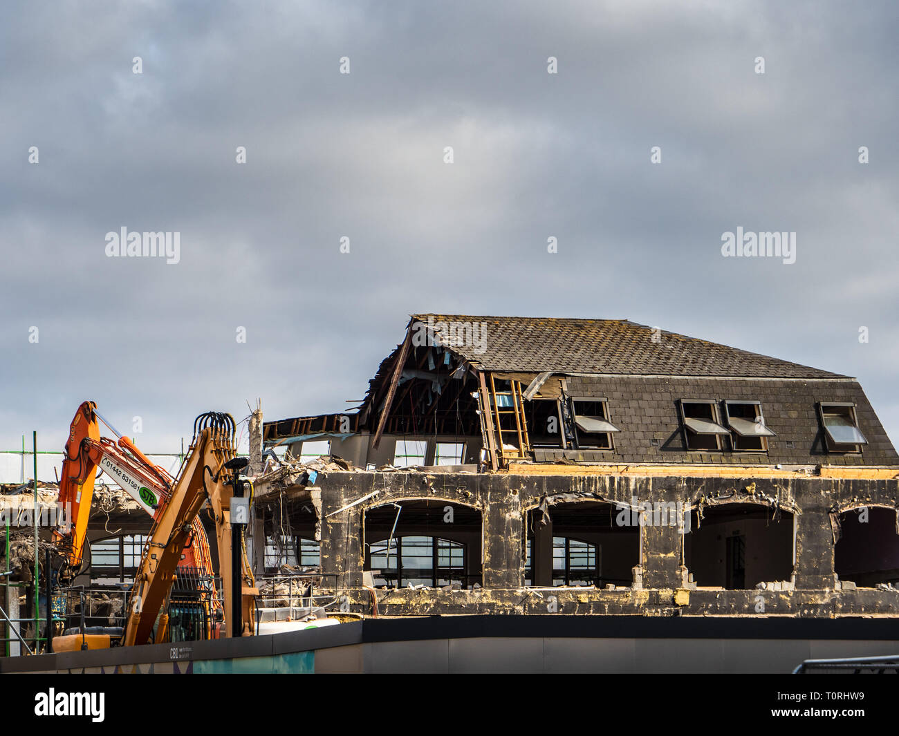 Demolition - old office building being demolished before redevelopment in Cambridge UK - Stock Image